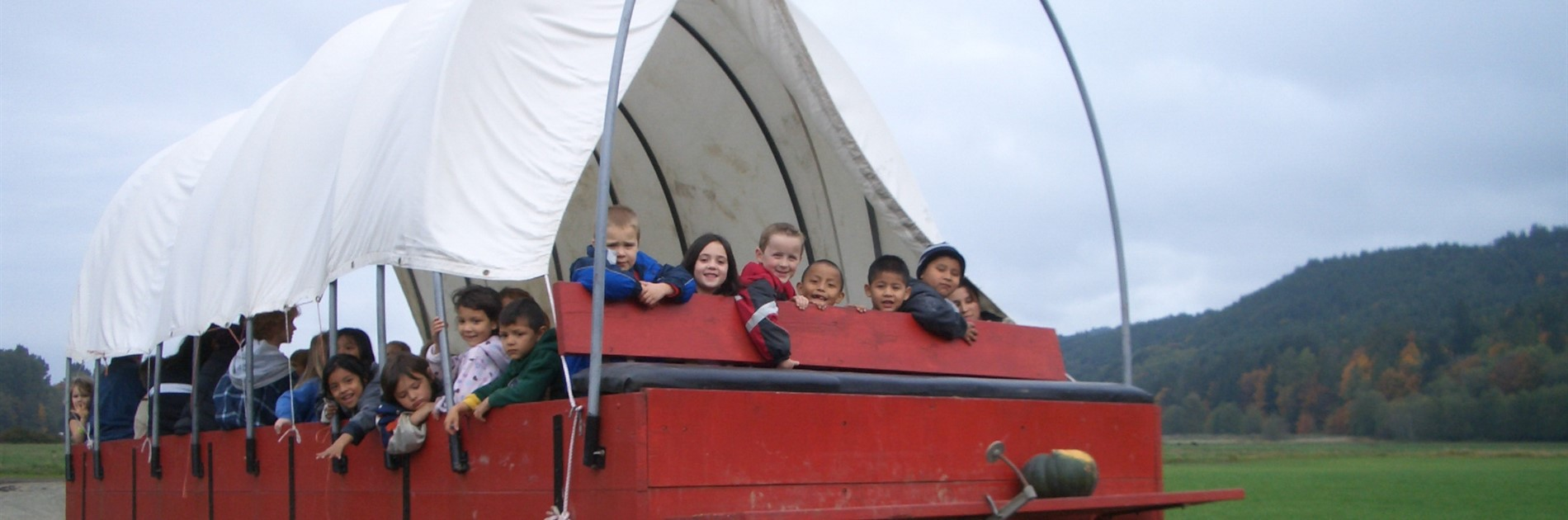 Students in covered wagon in October