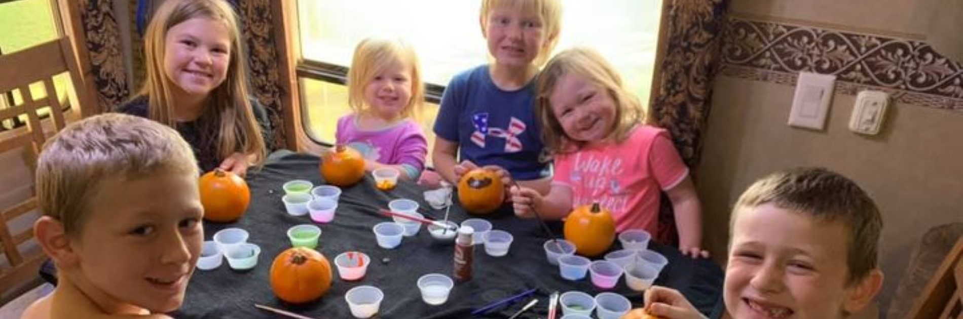 Students decorating pumpkins